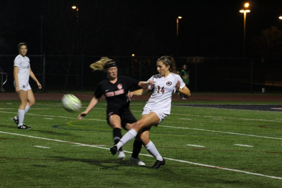 Grace Toupin '20 goes head to head against an enemy Ranger to try and pass the ball to a teammate. She was able to successfully get the ball away from her opponent, helping out her team.