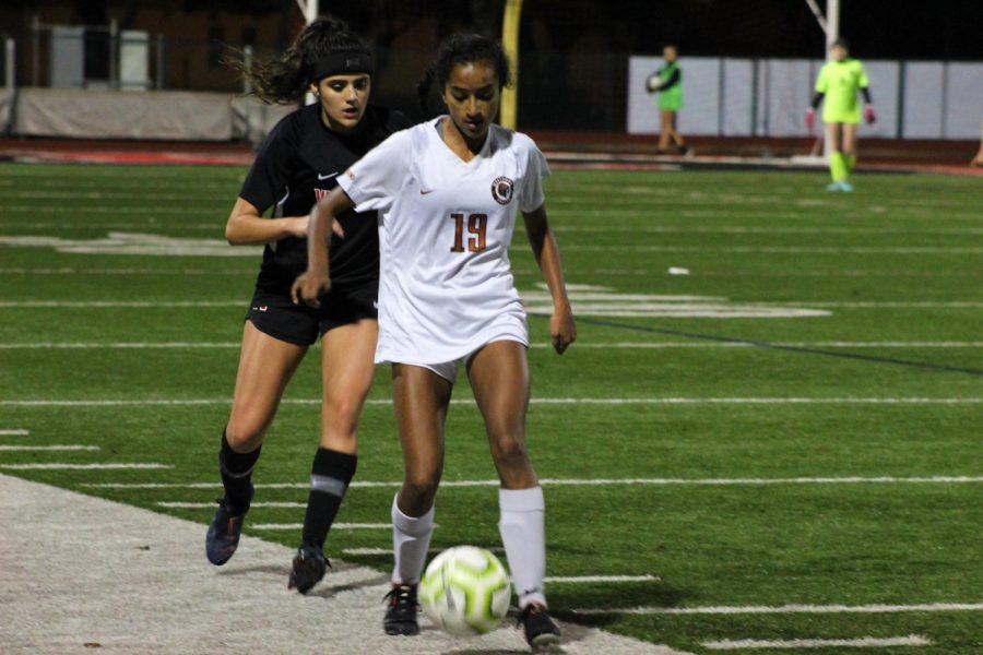 Deepti Choudhury '21 goes up against a Ranger to try and get a cross off and help her team. That is her main responsibility as an outside forward.