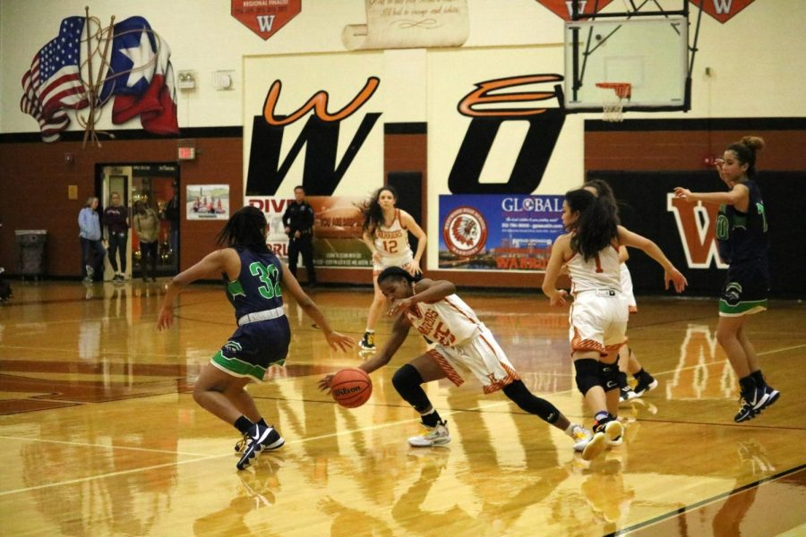 Mahogany Wright '23 fearlessly dives for the ball in order to give it back to the Lady Warriors. She ended up on the floor with a rival Maverick standing over her trying to get the ball back, wright was able to successfully get the ball to her team.
