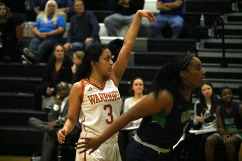 Serena Baruah '21 focuses in after shooting a free throw. The Lady Warriors were allotted a free throw after an enemy Maverick blocked the shot Baruah tried to make and pushed her onto the ground.