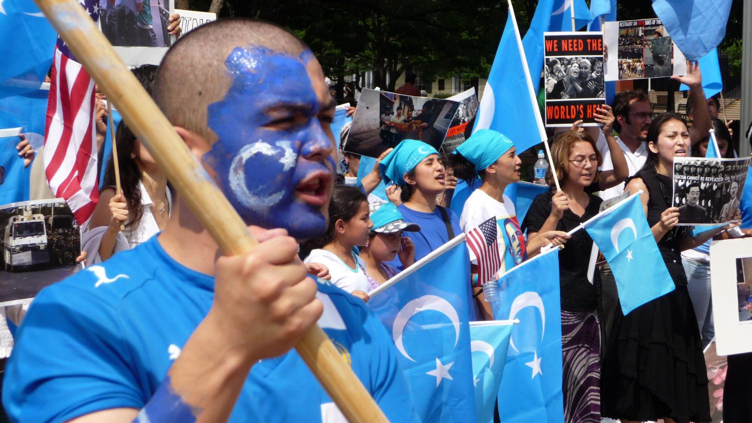 Protesters hold a rally outside the White House against China's treatment of Uighurs on July 10, 2009. Five days earlier, hundreds of Uighurs led riots in Xinjiang, China that quickly escalated into violence.