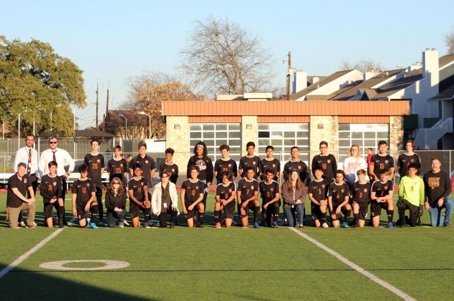 Westwood's soccer team takes a moment at half time to appreciate the teachers. It was teacher appreciation night tonight at the warrior's home game.