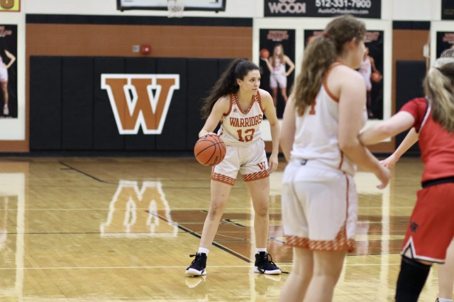 Looking around, Desi Davalos '22 tries to find someone to pass the ball to. Davalos plays as a guard or power forward for the Warriors.