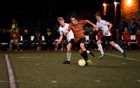 With a Ranger trailing on his side, forward Niko Djordjevic '21 dribbles the ball upfield. Djordjevic advanced the ball and made a successful pass.