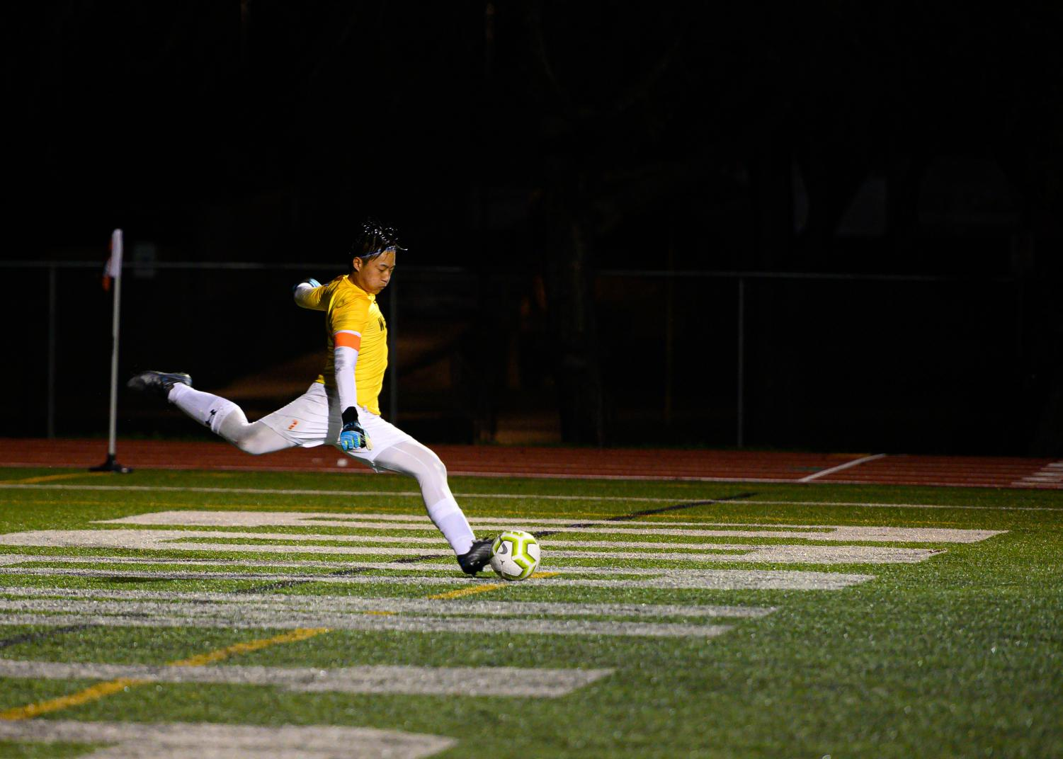 Running+towards+the+ball%2C+goalkeeper+Justin+Lang+%2720+kicks+the+ball+down+field.+Lang+blocked+a+lot+of+close+shots+throughout+the+game+never+allowing+the+offensive+team+to+score+a+single+goal.
