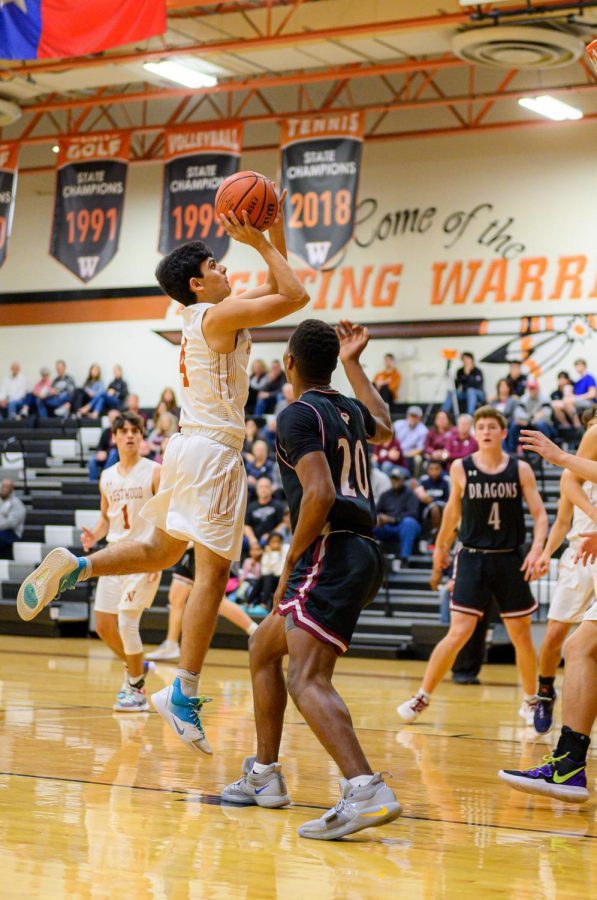 Jumping in the air, Arjun Seth '21 shoots a two pointer. Seth scored 5 out of the 12 points scored during the third quarter.