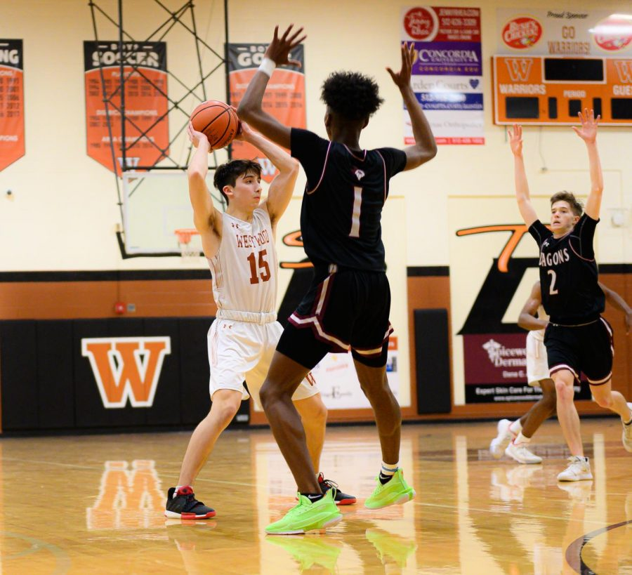 Santi Campos '20 scans the court to find a teammate to pass too. During the last play of the game, Campos brought the team to a victory with a last second layup.