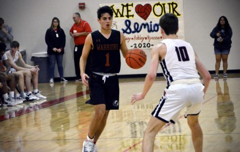 Preparing to start the next offensive series, guard Marcos Martinez '20 gets set to take on his defender. The Warriors weren't able to get a bucket on this possession, though.