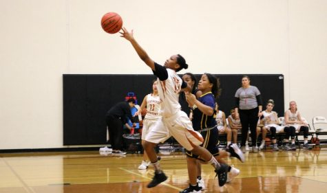 Loosing her grip, Kl'che Brown '23 attempts a layup. Brown was a significant defensive player for the team and helped push forward for an early lead.