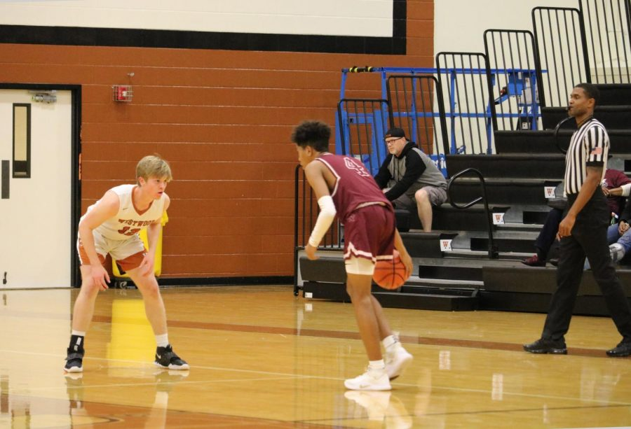 Jake Davis '22 guards a Round Rock player. Unfortunately, the Warriors' defense did not stop the Dragons on this possession.