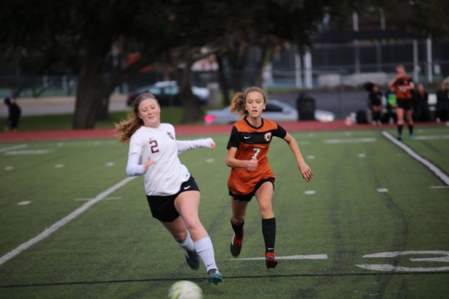 Midfielder Mia Bibbo '23 attempts to recover the ball from her opponent. The first half of the game was much more offense-based, but the Lady Warriors were still unable to score.