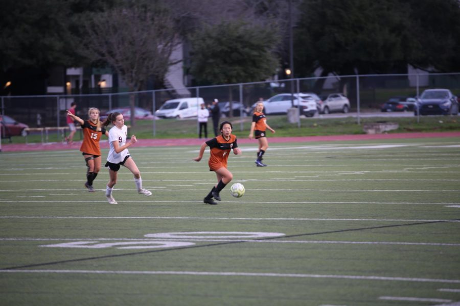 Quickly moving down the field, Midfielder Padt Skawratananond '23 keeps the ball away from her opponents. She was successfully able to pass it on to her teammates playing offense.