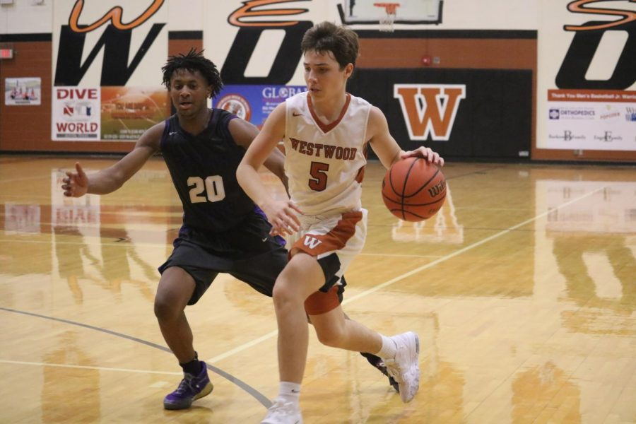 Karsten Bresser '22 weaves through Cedar Ridges' defense. Bresser plays point guard for the JV team.
