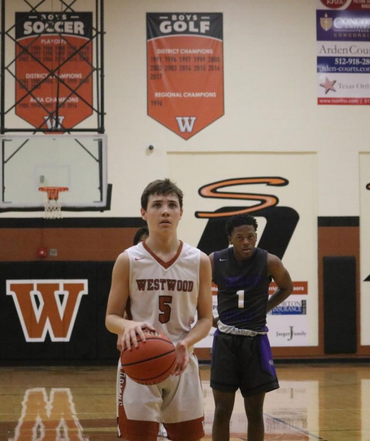 After getting fouled by an opponent, Karsten Bresser '22 shoots two free throws. Both shots were successful, adding points to the Warriors' score.