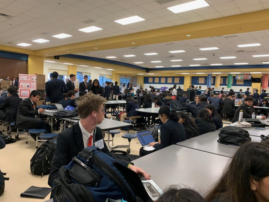 Students spend time in the cafeteria as they wait for events to begin. Many students were practicing their presentations at this time.