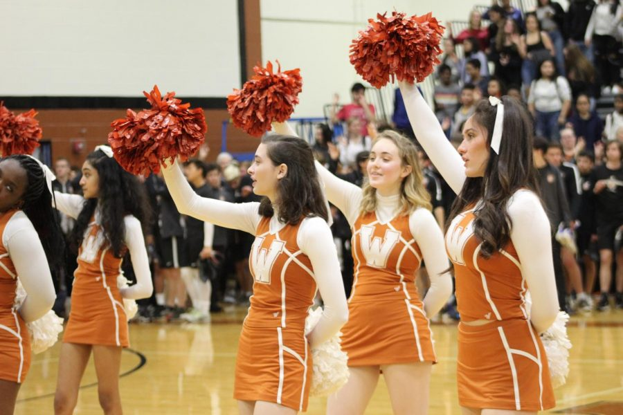 Cheerleaders wrap up the pep rally with the Alma Mater.  The students joined in to show their school spirit.