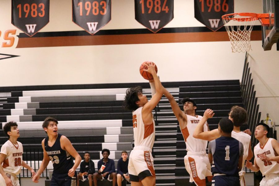 Josh Choy '22 shoots in the lane. The Warriors quickly gained a lead in the second quarter and sustained it throughout.