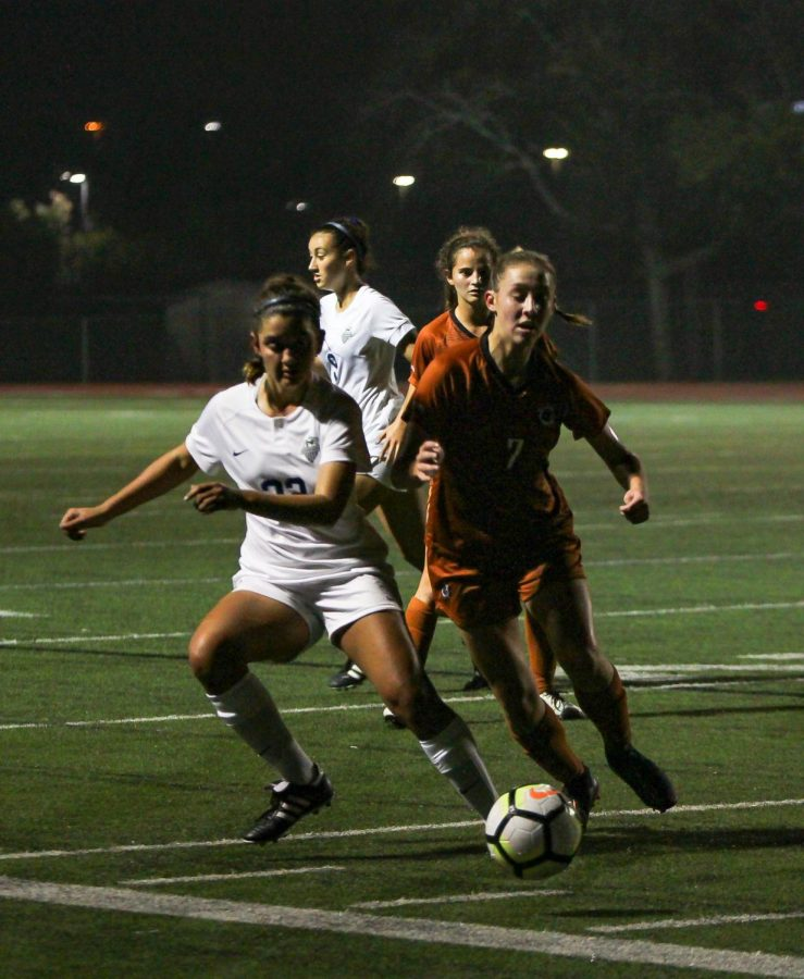 Skylar Zinnecker '23 battles for the ball during the first half of the game. The teams ended the half 0-0.