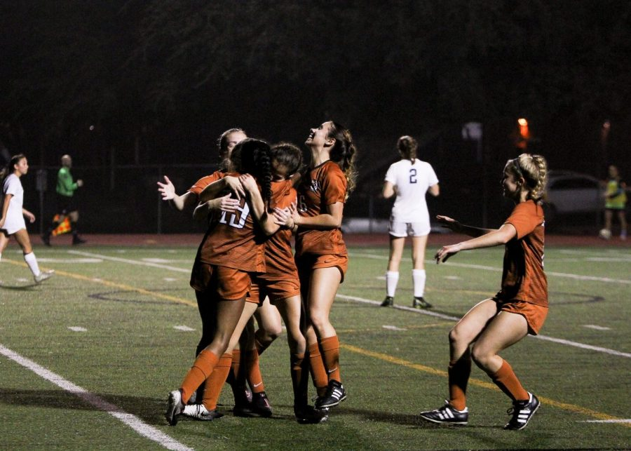 The team celebrate after scoring their first goal. Both goals were scored by Westwood in the second half of the game.