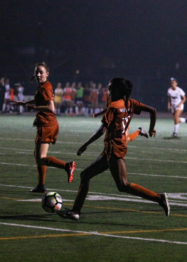 Deepti Chowdhury '21 winds up to shoot a goal. Chowdhury scored both goals of the game.