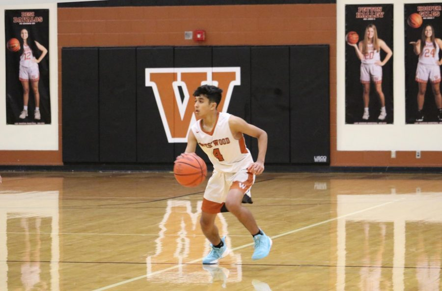 Vijay Kapistalam '21 crosses half-court, looking for an open teammate. He was quickly swarmed by Dragons trying to get the ball.