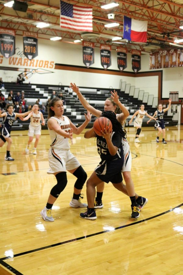 Playing man-to-man defense, Emma Goolsbey '21 and Gabbi Wallace '22 attempt to pressure a threatening offense put up by the Mavericks. Goolsbey, who later gained possession of the ball, fouled, and was given the opportunity to shoot free throws.