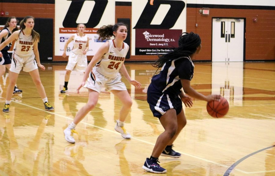 Getting ready to take on her defender, Makenzie Ward '23 anticipates the next move. The Lady Warriors' steadfast defense prevented the Mavericks from scoring in this possession.