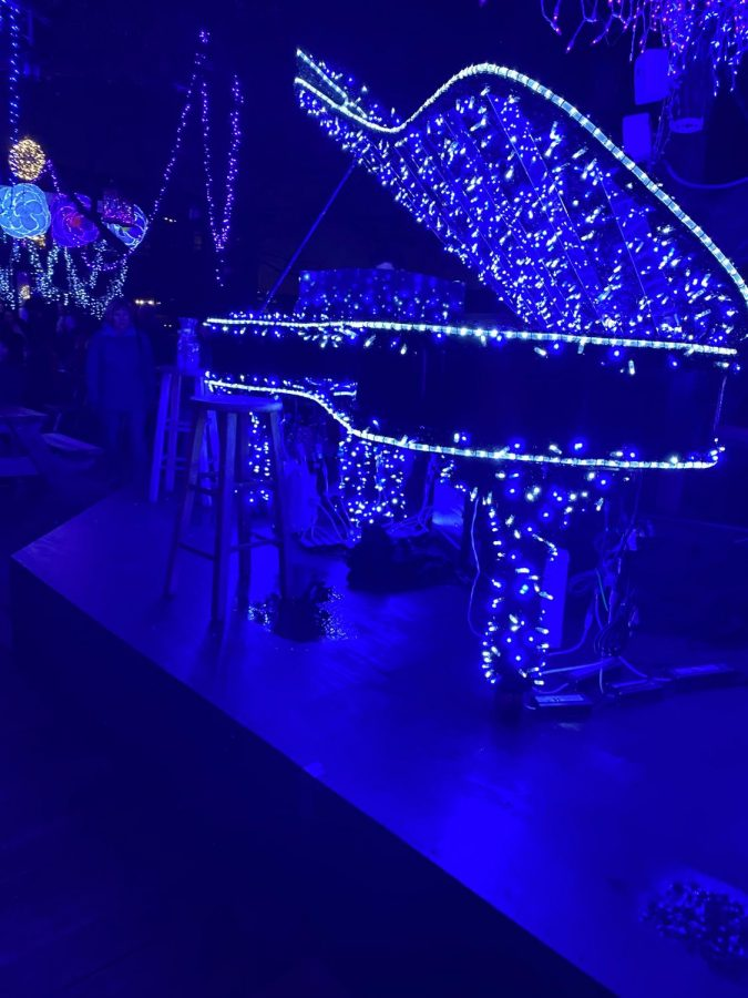 The grand piano is decked out with sparkling blue lights, adding to the grandeur of the live performances.