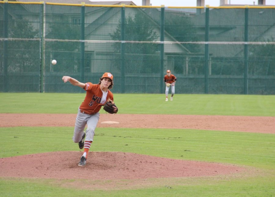 Nathan Potter '20 pitches the ball to the opposition's hitter. This pitch resulted in the hitter getting a second strike, which brought the score up to one ball and two strikes.