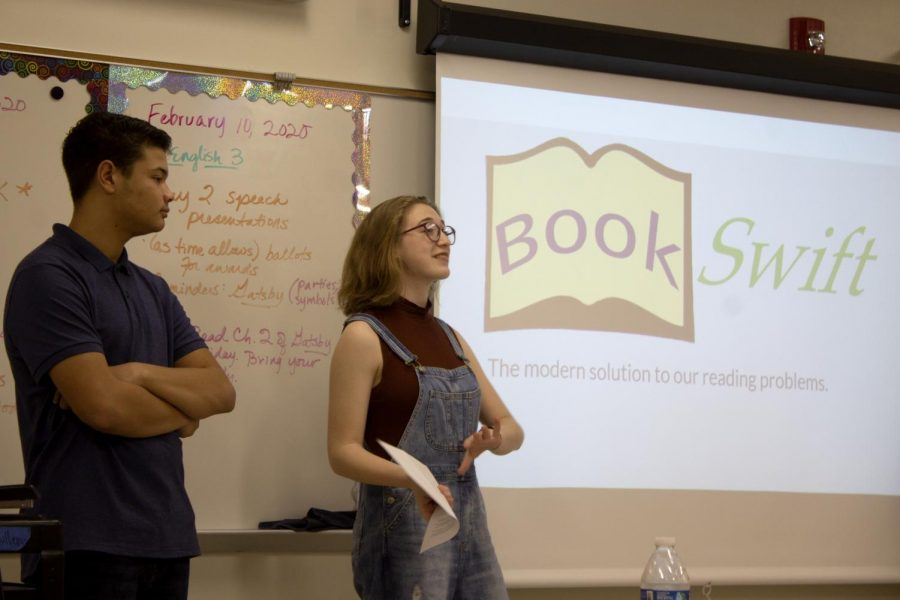 Sophie Steinhauser 22 and Emerson Heard 22 present their product for the sharks. Their product was a library book delivery system called Book Swift.