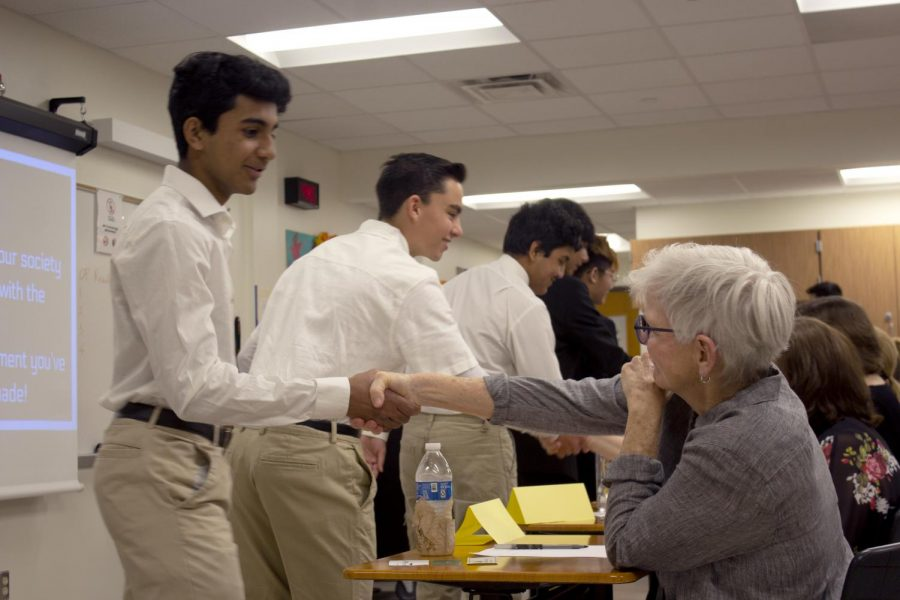 Govind Ramesh 22 shakes a sharks hand after his groups presentation. Their group was chosen to be invested in by a shark.