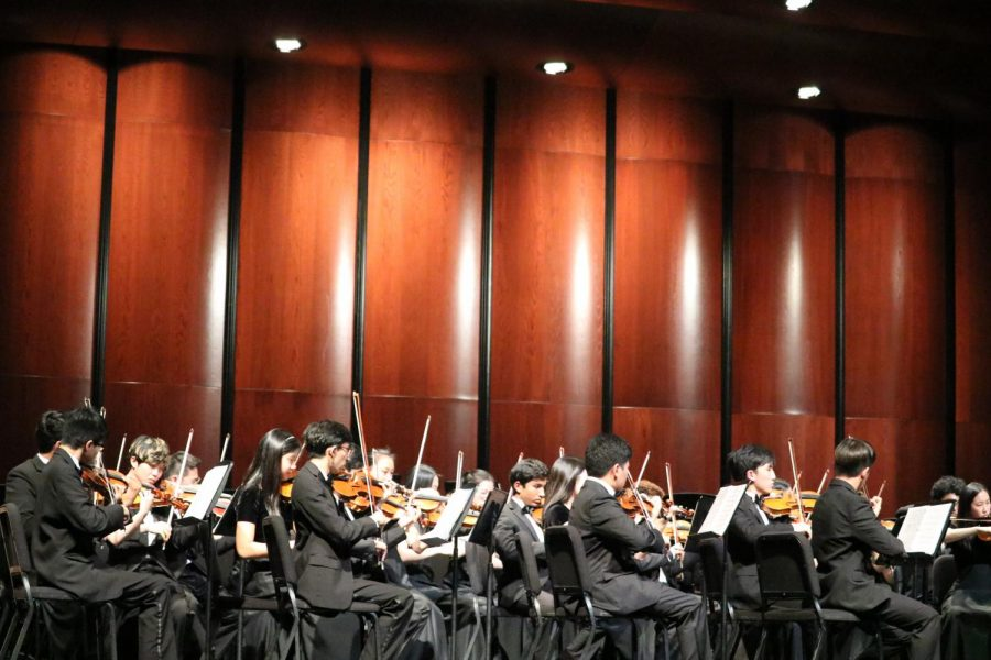 The first violins play 'Allegretto' from 'Symphony no. 7'. This song was a new piece that Symphony learned and didn't play for the Midwest Clinic in December.