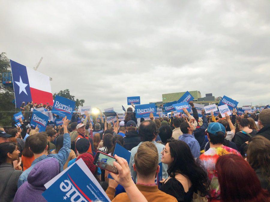 Thousands raise their signs as Bernie Sanders speaks of his plans for his presidency.