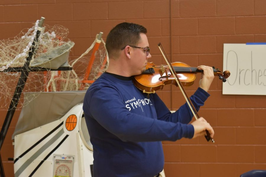 To demonstrate the orchestra program, Mr. Justin Anderson plays viola. Mr. Anderson is the Associate Orchestra Director at Westwood.