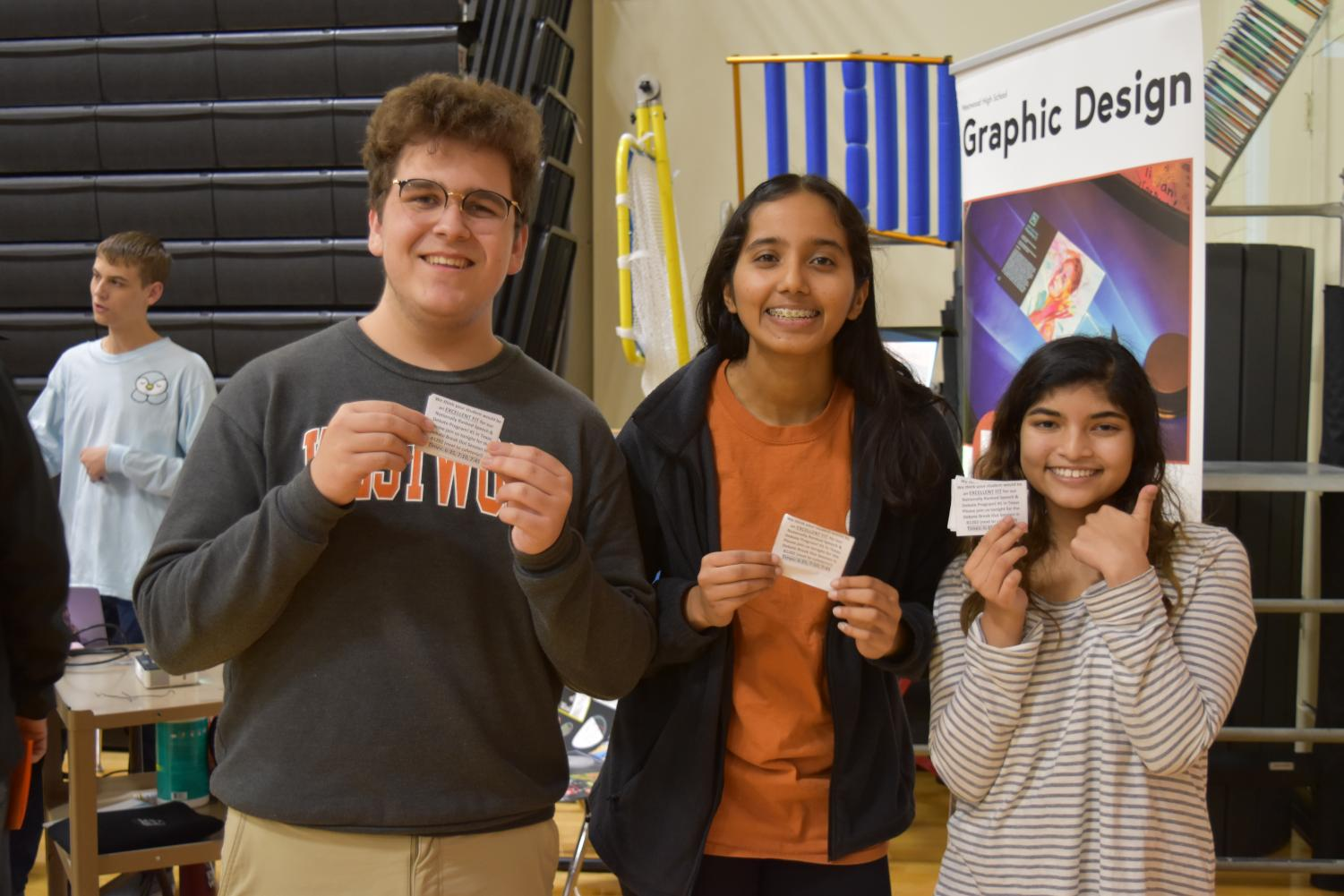 Bryce+Keeler+%2721%2C+Vaishnavi+Marreddy+%2722%2C+and+Shawkin+Kabir+%2721+take+a+photo+together.+During+the+event%2C+Keeler%2C+Marreddy%2C+and+Kabir+handed+out+flyers+informing+parents+and+students+of+the+debate+breakout+session.
