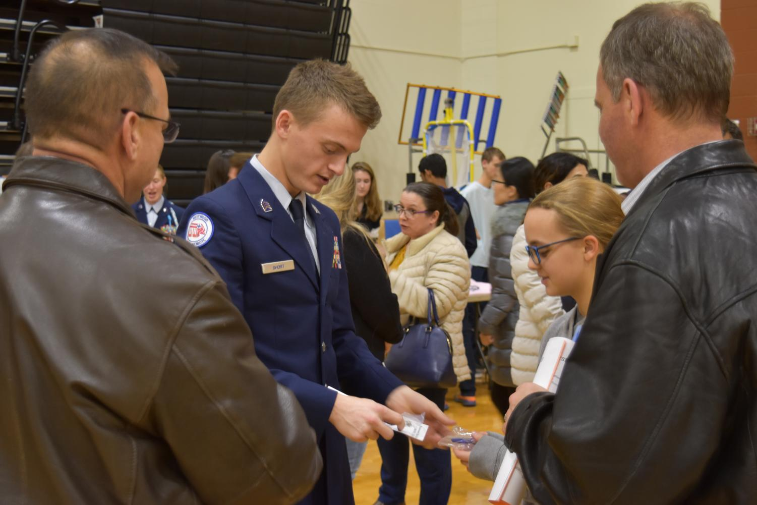 Representing+AFJROTC%2C+Chase+Short+%2720+hands+out+souvenirs.+In+9th+grade%2C+AFJROTC+students+take+Aerospace+Science+I.