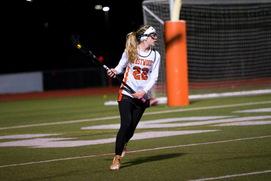 Running+with+the+ball%2C+Sarah+Poppe+%2722+looks+for+an+open+teammate+to+make+a+pass+to+against+Westlake.+With+last+year%27s+lacrosse+season+heavily+shortened+due+to+the+COVID-19+pandemic%2C+the+%22Try+It%22+clinic+provided+newfound+enthusiasm+for+the+team+heading+into+the+upcoming+season.