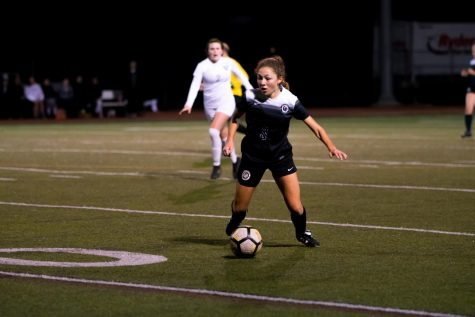 Andrea Pena '22 dribbles the ball downfield. Pena pushed through the Vipers' defense in attempt to set up a shot.