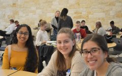 Arundhati Subramanian '21, Rosie Deal '22, and Marina Oquendo '22 rest in the cafeteria after being judged. The gallery walk in the gym was going to start in a few minutes.
