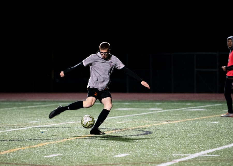 During practice before the game, Louis Niemerg '21 and his team practice scoring goals to warm up. Niemerg was a dominant offensive player during the game and scored a goal.
