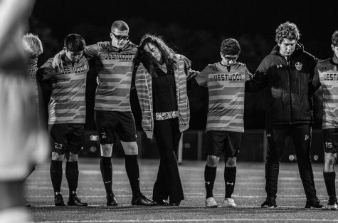 Louis Niemerg '21, his host mother, and the team stand for a moment of silence to honor his brother who passed away the day before the game. During the game, Niemerg scored one goal and honored the life of his brother.