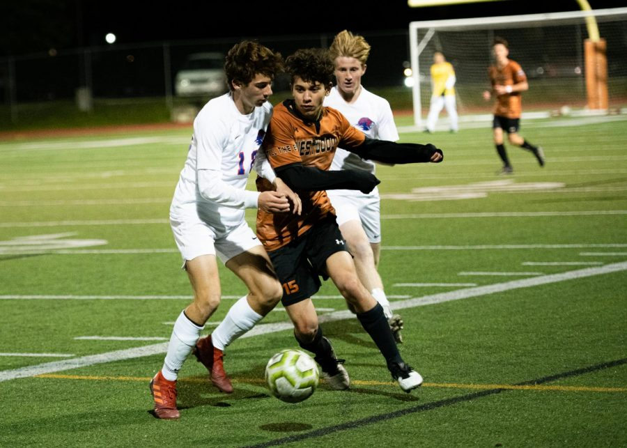 Luca Cipleu '21 weaves past the defenders and chases after the ball. Cipleu was a strong offensive player and was able to add another goal to Westwood's already dominant lead.
