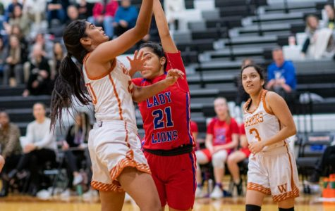 Guard Anisha Chintala '21 shoots a layup. The layup added 2 points to the score, increasing the Lady Warriors' lead to  33-12.