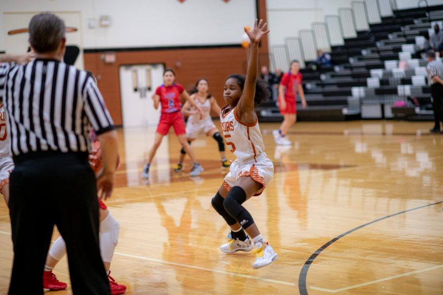 Guard Mahogany Wright '23 blocks an enemy Lion from passing the ball to her teammates. Wright is the only freshman that made the varsity team.
