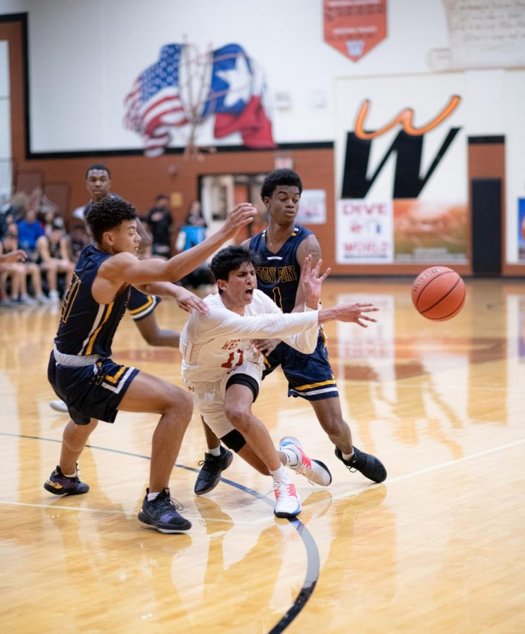 Losing control of the ball due to a foul, Anish Maddipoti '20 quickly passes the ball to a teammate. The referees called the foul and gave the Warriors two free throws.
