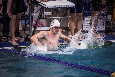 Caleb Farris '20 celebrates the 4 x 50-yard free relay victory and the fastest split in the field of 20.28. He is committed to swim Division I at American University in the fall.