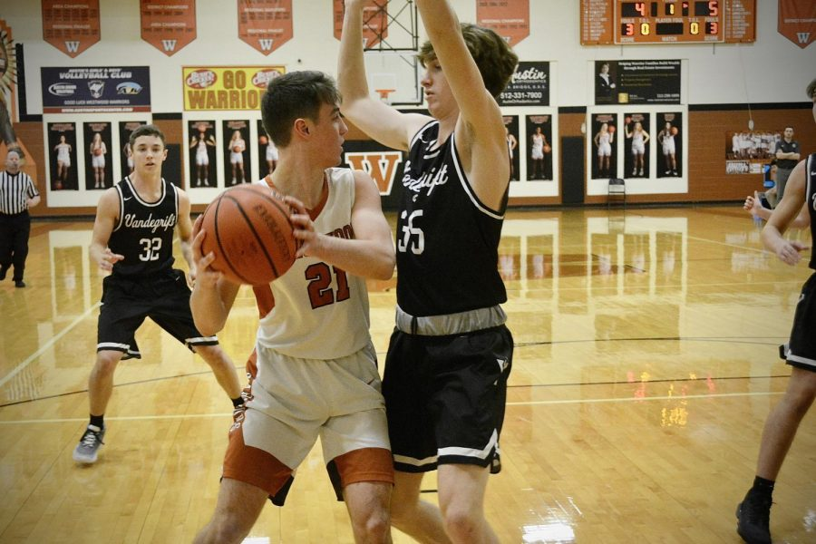 Smothered by a Viper, Blane Holschuh '21 looks for a teammate to pass to. Holschuh was a key offensive contributor for the Warriors in the win.
