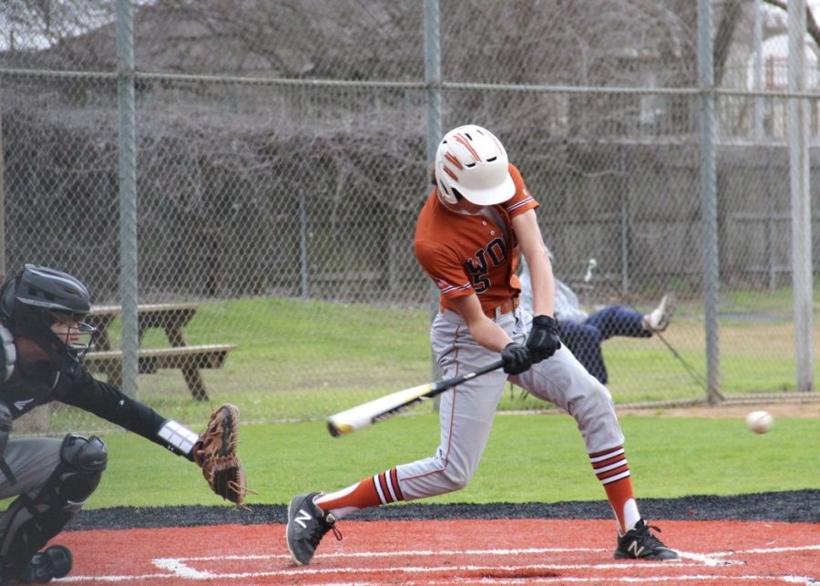 Swinging at the ball, Nathan Potter '20 prepares to take a hit at the ball. This hit put the ball into play and resulted in Potter making it to second base.