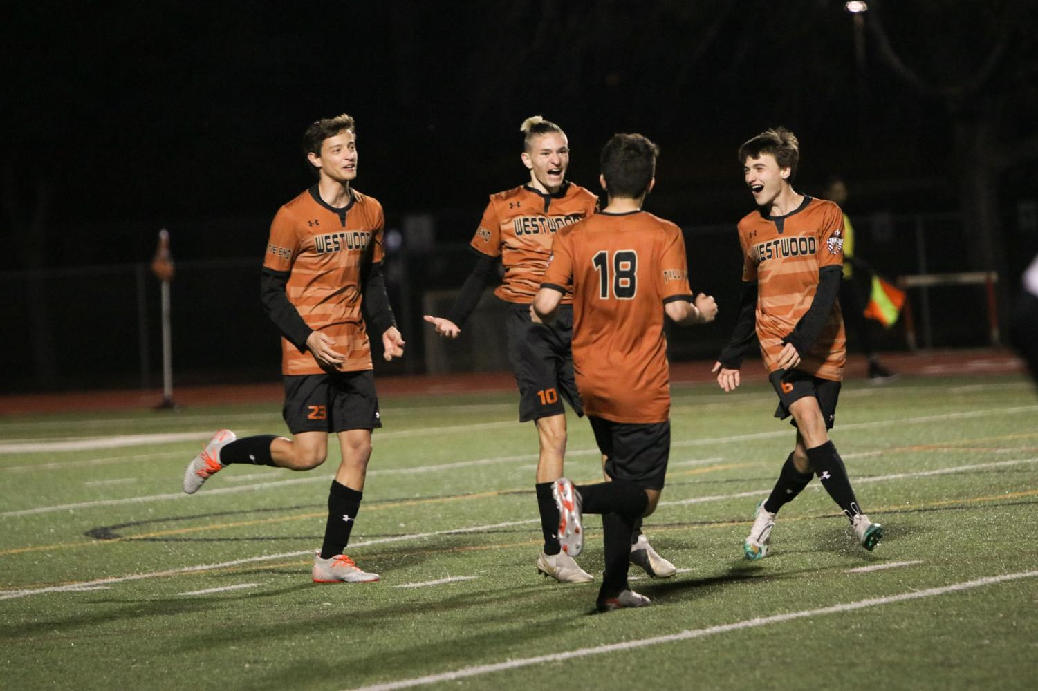 The+Warriors+celebrate+after+Niko+Harris+%2720+scores+a+goal.+This+was+the+final+goal+of+the+night%2C+making+the+score+3-0.