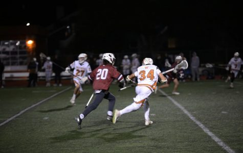 Jack Baddour '20 attempts to prevent an enemy Dragon's advance during a defensive play. The Dragons scored several times during the third quarter, creating an enormous lead.